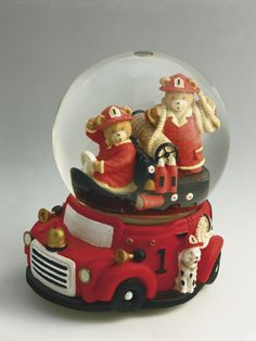 Close-Up of Figurines of Two Teddy Bears as Firemen in a Snow Globe Photographic Print at AllPosters.com