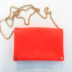 Coral Handbag Coral handbag with gold strap. Inside has 2 zip pockets and pocket without a zip. Worn once. In amazing condition. Very faint line can be seen on the back of the bag. Purchased at Urban Outfitters. Brand is Street Level. Urban Outfitters Bags Crossbody Bags