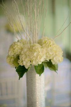 wedding centerpiece--hydrangeas in a silver vase with white branching