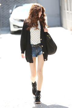 Black high top sneakers / lace up ankle boots, jean shorts, polka dot shirt, black cardigan.