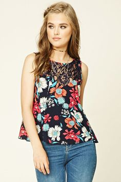 A woven top featuring a floral print, illusion neckline, front floral lace…