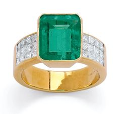 An Emerald and Diamond Ring  Centering a bezel-set emerald-cut emerald weighing approximately 6.75 carats, the broad shoulders accented by panels of invisibly-set princess-cut diamonds, mounted in 18k gold