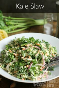 A crunchy and flavor packed kale slaw recipe, dressed with a creamy lemon and garlic dressing. Perfect as a side dish to BBQ meats, fried chicken, or lobster! via Farmhouse Recipes Slaw Recipes, Healthy Salad Recipes, Veggie Recipes, Whole Food Recipes, Healthy Eats, Healthy Foods, Free Recipes, Fried Chicken Side Dishes, Recipes