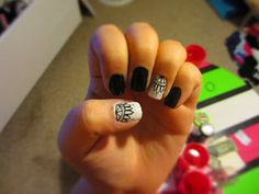 Black white and silver nail art design