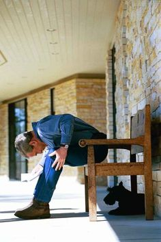 George W. Bush looks at his dog Barney while on his ranch: | The 42 Best Photos Ever Taken Of White House Pets