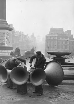 Men fixing the loudspeakers in Trafalgar Square, London, in readiness for the King's VE-day speech. (Photo by Harry Shepherd/Getty Images)