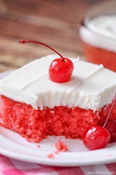 Cherry Sheet Cake - a moist, cherry jello cake topped with a homemade almond buttercream frosting! SO delicious!!