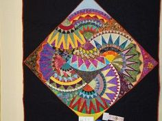 wow. could stand and look at this quilt for hours..... but I wouldn't volunteer to piece it!!