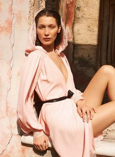 Looking pretty in pink, Bella Hadid poses in dress with lace hood