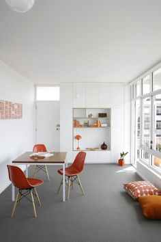 Apartment Barnes McManus - Tribe Studio Architects  {Designed for two bridge enthusiasts, the apartment refurbishment celebrates its owners collection of games paraphernalia. Views over Bondi Beach and Sydney Harbour are framed by intricate joinery displays, juxtaposing the close and distant views. In the limited space, all opportunities are taken to design in storage spaces and frame internal views through elements highlighted with bold colour.}