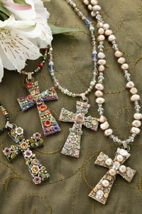 Love when the Cross is show cased with Swarovski Crystal and beautiful stones.