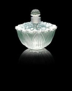 René Lalique (French, 1860-1945) 'Helene Lotus' a Perfume Bottle and Stopper, design 1928 clear glass, frosted and heightened with green staining 6.7cm high, engraved 'R.Lalique France'