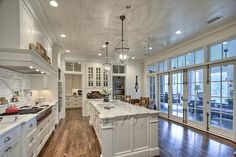 "this is what I want MY Kitchen to be. is an exact 10+ out of 10 pitch and roof line is too low, unless house is a  ""T"""