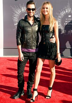 Adam Levine and wife Behati Prinsloo made their first public appearance together since their Mexico nuptials last month at the 2014 MTV Video Music Awards. Did they coordinate those all black outfits??