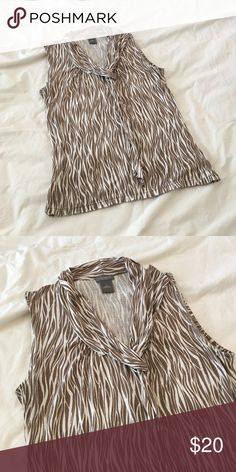Brown and cream Ann Taylor sleeveless blouse. Brown and cream AT sleeveless blouse. Small petite. Transitions nicely from summer to fall. Ann Taylor Tops Blouses