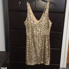 Bebe Gold Sequin Mesh Cutout Dress Gorgeous! Absolutely stunning. Runs a little big/stretchy, could definitely fit a medium. Worn just once. Only selling to help my mom out financially ❤️ bebe Dresses