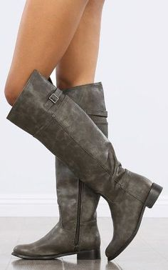 """Adorable riding boots in grey are a must have for any outfit. These riding boots are of high boutique quality. Grab yourself a pair today! Available in sizes 6-11. Fits true to size. Heel: 1"""" Shaft: 1"""