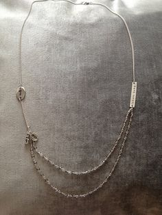 Long silver necklace, inspired by the Fifty Shades of Grey trilogy novel by E.L. James.  $32  #fiftyshadesofgrey   #50shadesofgrey  #latersbaby  #eljames  #christiangrey