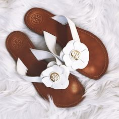 Tory Burch 'Breely' Sandals  Beautiful authentic Tory Burch 'Breely' sandals in white! Some wear, as shown in photos, but all wear is covered by the foot when worn! Size 7M. These are perfect with a flowy sundress or for a day at the pool! Give these beauties a new home  Tory Burch Shoes
