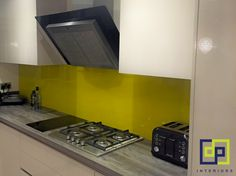 bright yellow kitchen splashback yellow green
