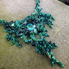 """""""Creature Of The Night"""" necklace - dichroic glass cabochon, TOHO and Matsuno seed beads, emerald, onyx and avanturine chips, spike beads"""