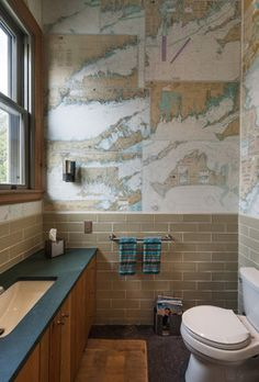 Wainscott Residence eclectic bathroom. Like this idea of covering a wall with maps for an office. Or perhaps framing maps for the wall. Places we've been or want to go to.