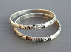 Africa | Pair of old silver Moor or Tuareg bracelet from Mauritania or South Morocco. Finely chased and decorated with red and black niello. Excellent alloy of silver content. | 120$