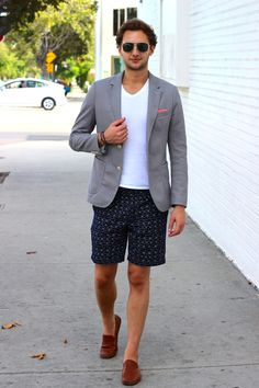 Shop this look for $167:  http://lookastic.com/men/looks/sunglasses-and-v-neck-t-shirt-and-pocket-square-and-blazer-and-shorts-and-driving-shoes/3111  — Black Sunglasses  — White V-neck T-shirt  — Neon Pink Pocket Square  — Grey Blazer  — Navy Print Shorts  — Tobacco Leather Driving Shoes