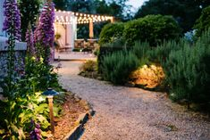 This copper path light add safety and style to this gravel path way. The fixture shoots light downward onto the walkway below to provide sure footing while also highlighting the bright greens and purples in the surrounding landscaping.