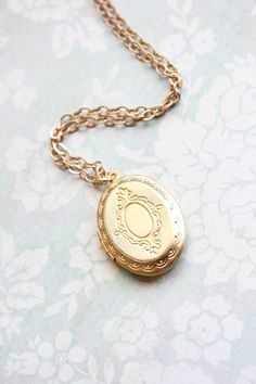 Gold Locket Necklace Oval Keepsake Locket by apocketofposies Gold Locket, Locket Necklace, Pendant Necklace, Necklaces, Pocket Watch Necklace, Long Chain Necklace, Bridesmaid Gifts, Unique Jewelry, Lockets