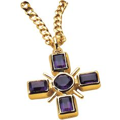 An unusual double-sided and 22ct. gold-plated pendant, with amethyst coloured glass stones on one side and a ruby coloured stone on the reverse. British Museum shop