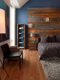 Love the wooden wall piece behind the bed and night stand.   master bedroom interiors