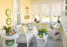 An enclosed porch comes out of hibernation. The wicker the better: This white bench complements the wicker furniture Mary Waight of Sycamore picked up at an antiques fair.