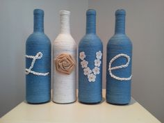 love yarn wrapped bottles by AngelBugsPartyOfOne on Etsy