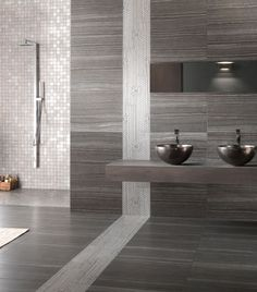 Eramosa Carbon 30x60cm wall & floor tile. A digitally-printed stone-effect porcelain gloss floor tile. Suitable for bathrooms and heavy traffic areas.