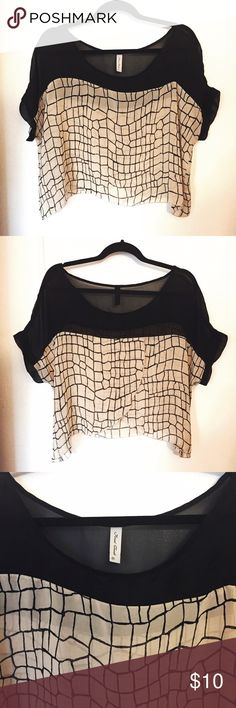 ✨NEW LISTING✨ Black/Tan Sheer Oversized Top Sheer oversized top with a square pattern. Can be worn as a cover up for at the beach or over a cute bralette or tank top. It's on the shorter side and can be worn as a crop top with some high waisted shorts or skirt, but it's not too short (covers below belly button). Very versatile, you can dress up or down. There's a cute slit on the back (see picture). Please comment below for additional sizing information. Tops