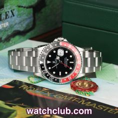 """Rolex GMT-Master II """"Coke"""" Bezel REF: 16710   Year Aug 2003 In lovely crisp condition this classic 'Coke' GMT is a real cracker... Complete with it's original Rolex box, warranty certificate, cockpit book and chronometre tag this GMT Master II is s superb example of Rolex's famous triple time zone pilot's watch. Fitted with the ever-reliable cal.3185 automatic movement, rugged sapphire glass and sturdy Oyster bracelet - for sale at Watch Club, 28 Old Bond Street, Mayfair, London"""