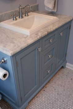 I really like the sink and the countertop is pretty, too.  The painted wood is charming, but I think I want stained wood instead.  Mainly pinned this because of the sink.  1920's period bathroom remodel featuring custom vanity with carrara marble top, Kohler memoirs sink