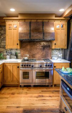 Idea of the Day: Stone and Copper Backsplash in a Timber-Frame Craftsman Kitchen. See More Backsplash Ideas. (By Crown Point Cabinetry). Kitchen Cabinet Styles, Wood Kitchen Cabinets, Kitchen Backsplash, Pine Cabinets, Copper Backsplash, Backsplash Ideas, Kitchen Stove, Kitchen Countertops, Log Home Kitchens