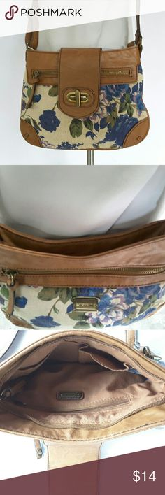 "Aldo small cross body purse Aldo Canvas/Faux Leather Small Cross Body Purse.   Excellent condition and clean.   Features; twist lock closure, front zipper pocket, zipper closure, adjustable cross body strap, rear zipper pocket, two inner slip pockets and one inner wall zipper pocket.   Length 10"" height 7.5"" strap drop 23""  Smoking and pets free home. Aldo Bags Crossbody Bags"