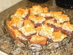 "German Chocolate Ooey-Gooey Butter Cake. Paula Deen's recipe... made these today for my in-laws. Sinful! Haha NO these to not get pinned to ""Healthy Life""!"