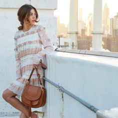 """""""It's everywhere on the street at #NYFW, and only at BG: meet the new It-Bag, the @chloe Hudson. Shop the style @negin_mirsalehi is carrying now through…"""""""