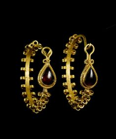 Pair of Parthian gold and garnet earrings c. 2nd-1st centuries BCE. From Bonhams auction house.