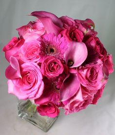 Beuatiful hot pink bridesmaids bouquet...roses, gerbera daisies, and mini callas