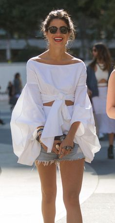 Completely obsessed with Leandra Medine's off-the-shoulder white top and cutoffs
