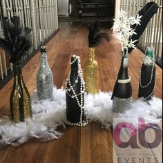 A Great Gatsby theme decor. Sparkles bottles, pearls, feathers, diamonds, gold, silver, black