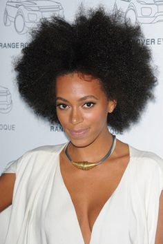 This is a fun and funky, Afro hairstyle. Solange Knowles has her hair curly. The hair is built up high and full. This celebrity looks great with this style. Towel drying is the best way to dry this type of hair.