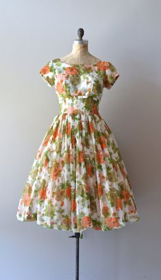 ✩ reserved for sophia ✩ please do not buy ✩  ✩ reserved for sophia ✩ please do not buy ✩  ✩ reserved for sophia ✩ please do not buy ✩        ✩ reserved for sophia ✩ please do not buy ✩  vintage 1960s airy layered chiffon dress with large floral print, wide neckline, short sleeves, fitted waist, full skirt, tie back belt and metal back zipper. --- M E A S U R E M E N T S ---    fits like: medium  bust: 34-36  waist: 28  hip: free  length: 45.5  brand/maker: n/a  condition: excellent    to…
