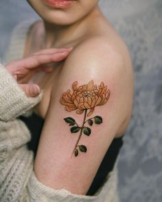 8d6c1769a Yellow chrysanthemum on her arm, done in New York in January.  #tattooistsion Yellow