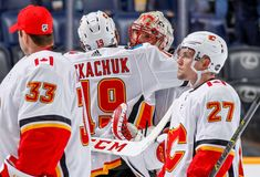 NASHVILLE, TN - OCTOBER Matthew Tkachuk hugs Mike Smith of the Calgary Flames after a win against the Nashville Predators at Bridgestone Arena on October 2018 in Nashville, Tennessee. (Photo by John Russell/NHLI via Getty Images) Ice Hockey Teams, Hockey Stuff, Mike Smith, Nhl Games, Nashville Tennessee, Calgary, Hugs, October, Sports